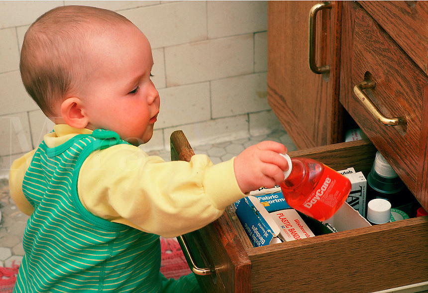 Infant plays with contents of the medicine cabinet