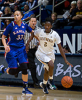 Afure Jemerigbe of California dribbles the ball away from Tania Jackson of Kansas during the game at Haas Pavilion in Berkeley, California on December 21st, 2012.  California defeated Kansas, 88-79.