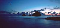 Three Arch Rocks, moonrise, sunset twilight, and first evening star rises over ocean. scenic seascape. Oceanside Oregon, Oregon Coast.