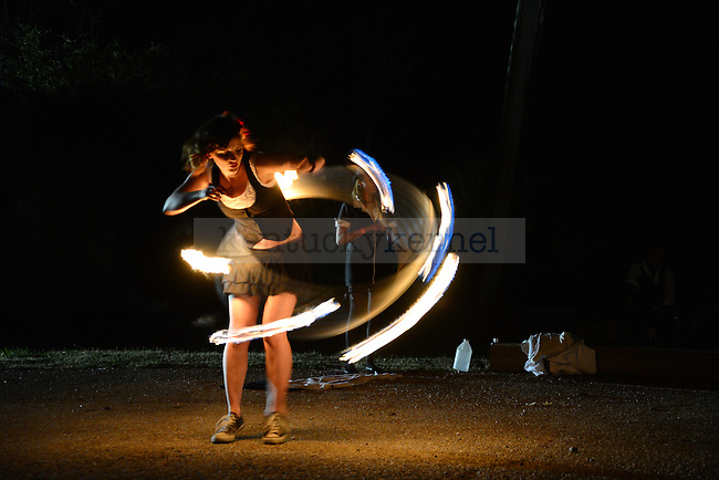 Nikita Stamm, a University of Kentucky graduate, performs with fire at Beaux Arts Ball, a late night rave hosted by the University of Kentucky College of Design in Lexington , Ky., on Saturday, April 13, 2013. Photo by Eleanor Hasken | Staff