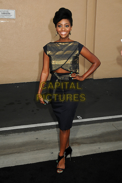 Teyonah Parris<br /> &quot;Breaking Bad&quot; Final Episodes Los Angeles Premiere Screening held at Sony Pictures Studios, Culver City, California, USA, 24th July 2013.<br /> full length hand on hip gold black striped top dress cut out midriff hand on hip clutch bag skirt <br /> CAP/ADM/BP<br /> &copy;Byron Purvis/AdMedia/Capital Pictures