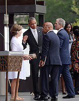 (L to R) : Former First Lady Laura Bush, United States President Barack Obama, U.S. Representative John Lewis (Democrat of Georgia) and former U.S. President George W. Bush attend the opening ceremony of the Smithsonian National Museum of African American History and Culture on September 24, 2016 in Washington, DC. The museum is opening thirteen years after Congress and President George W. Bush authorized its construction. <br /> Credit: Olivier Douliery / Pool via CNP / MediaPunch