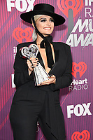 14 March 2019 - Los Angeles, California - Bebe Rexha. 2019 iHeart Radio Music Awards - Press Room held at Microsoft Theater. Photo Credit: Birdie Thompson/AdMedia