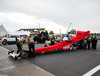 Aug 18, 2017; Brainerd, MN, USA; Crew members cover the dragster of NHRA top fuel driver Terry McMillen during a rain delay to qualifying for the Lucas Oil Nationals at Brainerd International Raceway. Mandatory Credit: Mark J. Rebilas-USA TODAY Sports