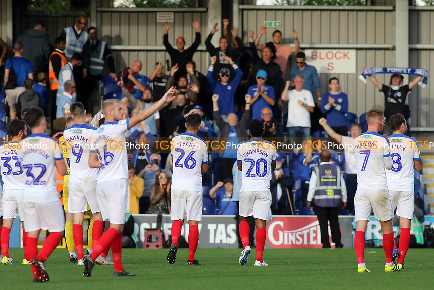 Portsmouth players applaud their fans at the end of the match as they celebrate their 2-1 victory during AFC Wimbledon vs Portsmouth, Sky Bet EFL League 1 Football at the Cherry Red Records Stadium on 13th October 2018