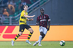 AC Milan Defender Cristian Zapata (R) plays against Borussia Dortmund Midfielder Andre Schurrle (L) during the International Champions Cup 2017 match between AC Milan vs Borussia Dortmund at University Town Sports Centre Stadium on July 18, 2017 in Guangzhou, China. Photo by Marcio Rodrigo Machado / Power Sport Images