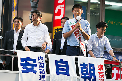 (L to R) Shinzo Abe, leader of the Liberal Democratic Party and Prime Minister of Japan, and Kentaro Asahi, former beach volleyball star and LDP candidate, speak during a campaign event in Shibuya on July 3, 2016, Tokyo, Japan. Abe came to support Asahi's campaign for July 10th's House of Councillors elections. (Photo by Rodrigo Reyes Marin/AFLO)