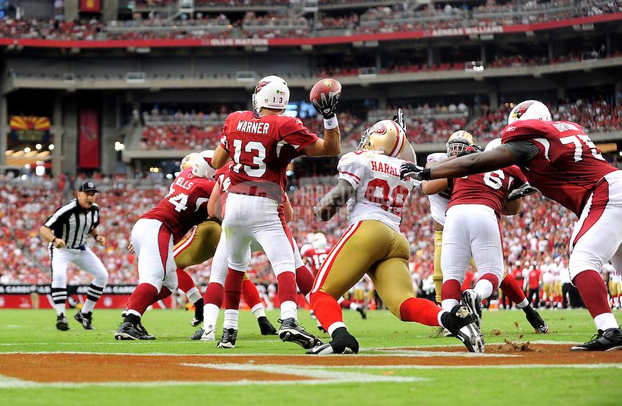 Sept. 13, 2009; Glendale, AZ, USA; Arizona Cardinals quarterback (13) Kurt Warner throws a pass under pressure from San Francisco 49ers linebacker (98) Parys Haralson in the third quarter at University of Phoenix Stadium. San Francisco defeated Arizona 20-16. Mandatory Credit: Mark J. Rebilas-