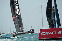25 July 2015: Oracle Team USA sail downwind during the America's Cup first round racing off Portsmouth, England (Photo by Rob Munro)