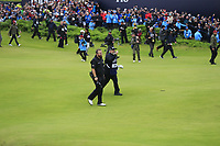 Shane Lowry (IRL) and caddy Bo walk onto the 18th green with a 6 shot lead during Sunday's Final Round of the 148th Open Championship, Royal Portrush Golf Club, Portrush, County Antrim, Northern Ireland. 21/07/2019.<br /> Picture Eoin Clarke / Golffile.ie<br /> <br /> All photo usage must carry mandatory copyright credit (© Golffile | Eoin Clarke)