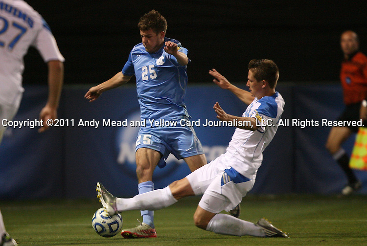 09 December 2011: UCLA's Matt Wiet (right) challenges North Carolina's Rob Lovejoy (25). The University of California Los Angeles Bruins played the University of North Carolina Tar Heels to a 2-2 tie after overtime, with the Tar Heels advancing with a 3-1 win in the penalty kick shootout at Regions Park in Hoover, Alabama in an NCAA Division I Men's Soccer College Cup semifinal game.