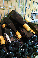 bottles stored in wire cages dom g amiot & f chassagne-montrachet cote de beaune burgundy france