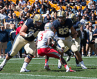 Pitt offensive lineman Matt Rotheram (74) and tight end Scott Orndoff (83) block New Mexico cornerback Cranston Jones (3). The Pitt Panthers defeated the New Mexico Lobos 49-27 on Saturday, September 14, 2013 at Heinz Field, Pittsburgh, Pennsylvania.