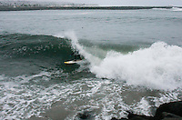 Kolo Rosenthal surfs in  the Mission Bay Channel between the Mission Beach and Ocean Beach Jetties at sunset on Saturday, January 5 2007.