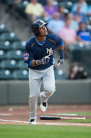 Eddy Martinez (51) of the Myrtle Beach Pelicans starts down the first base line against the Winston-Salem Dash at BB&T Ballpark on May 11, 2017 in Winston-Salem, North Carolina.  The Pelicans defeated the Dash 9-7.  (Brian Westerholt/Four Seam Images)