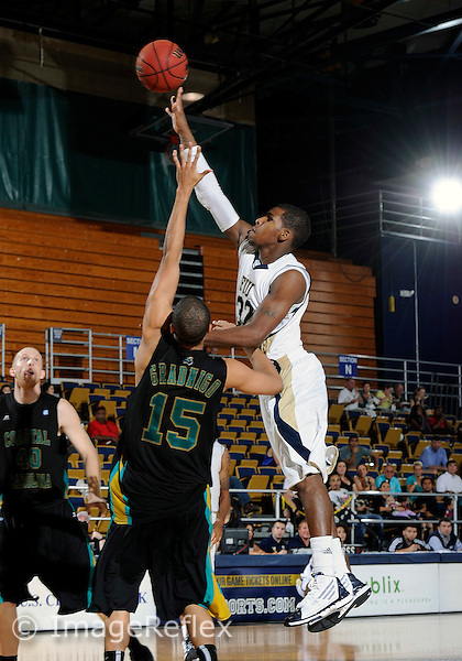 Florida International University guard Jeremy Allen (32) plays against Coastal Carolina University.  FIU won the game 64-62 on November 26, 2011 at Miami, Florida. .