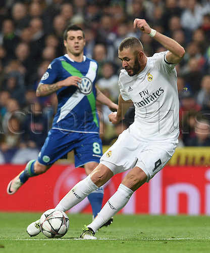 12.04.2016. Madrid, Spain.  Wolfsburg's Vieirinha (L) in action against Karim Benzema of Madrid during the UEFA Champions League quarterfinal second leg  match between Real Madrid and VfL Wolfsburg at the Santiago Bernabeu stadium in Madrid, Spain, 12 April, 2016.