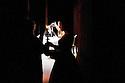 "In the backstage, Maria Laura Rondanini, actress, takes a candlestick from the hands of an attendant and is about to go on stage in the theater piece Rameau's Nephew by Denise Diderot, directed by Silvio Orlando at Elfo-Puccini Theatre, Milan, March 2013. © Carlo Cerchioli..Nelle quinte, Maria Laura Rondanini, attrice, prende un candeliere da un inserviente e sta per entrare in scena nella piece teatrale ""il nipote di Rameau"" di Denis Diderot diretto da Silvio Orlando al Teatro Elfo-Puccini, Milano marzo 2013."