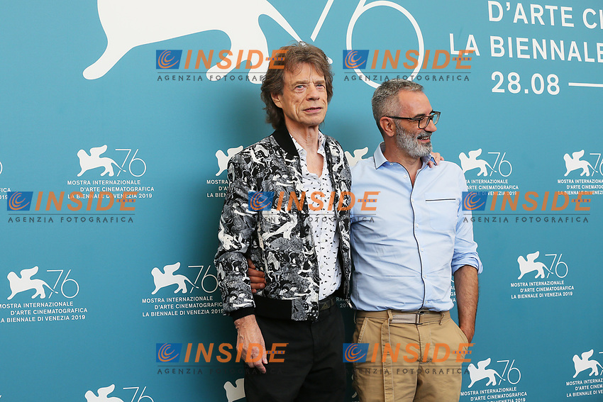 "VENICE, ITALY - SEPTEMBER 07: Mick Jagger and Giuseppe Capotondi attend ""The Burnt Orange Heresy"" photocall during the 76th Venice Film Festival at Sala Grande on September 07, 2019 in Venice, Italy. (Photo by Mark Cape/Insidefoto)<br /> Venezia 07/09/2019"
