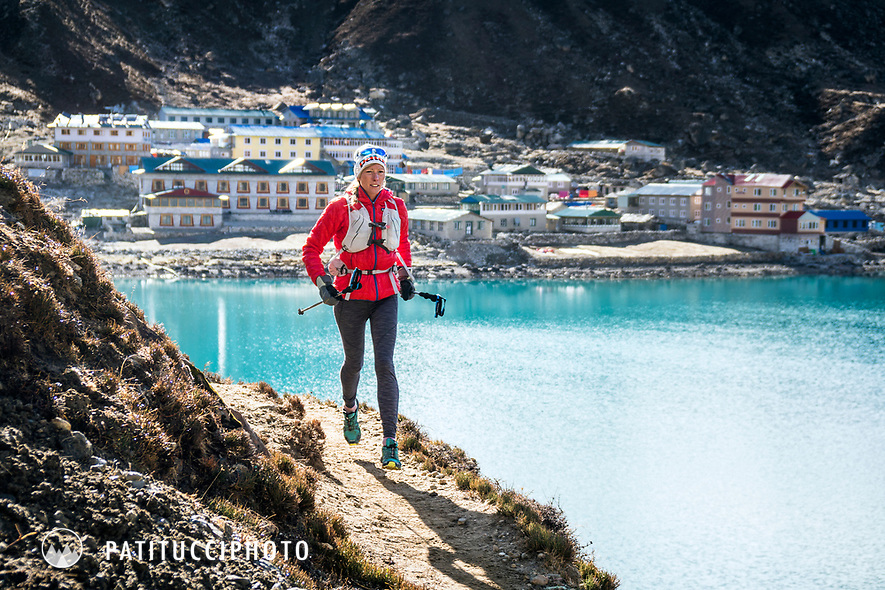 A trail runner leaving Gokyo behind and starting up Renjo La Pass, the third pass of the 3 Passes Tour, Khumbu Valley, Nepal.