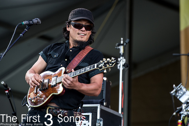 Michael Kang of The String Cheese Incident performs during the New Orleans Jazz & Heritage Festival in New Orleans, LA.