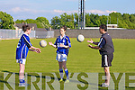Learning the new pass from referee Paul Hayes, were girls of Kerins O'Rahilly's GAA Club Under 14 Cli?odhna Hayes and Caoimhe Crowe.................................... ....