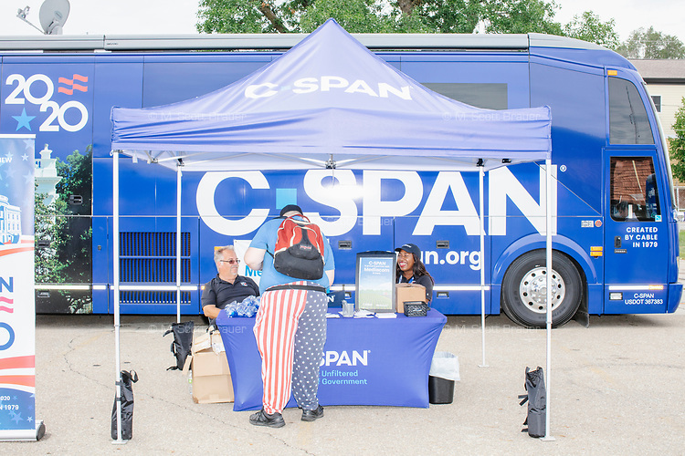 The C-SPAN booth and bus stands just off the Grand Concourse at the Iowa State Fair in Des, Moines, Iowa, on Sun., Aug. 11, 2019. Many political candidates stopped at the bus for interviews with C-SPAN after talking at the Political Soapbox.