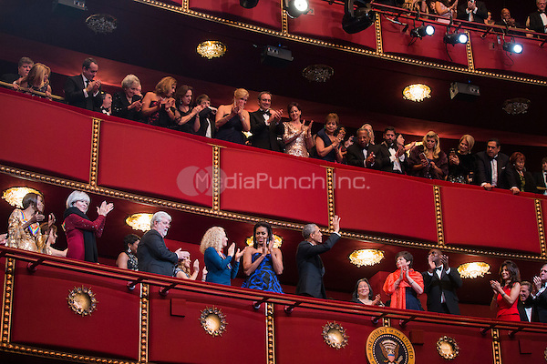 United States President Barack Obama and First Lady Michelle Obama attend the Kennedy Center Honors at the Kennedy Center in Washington, DC, USA, 06 December 2015.  The 2015 Kennedy Center honorees are: singer-songwriter Carole King, filmmaker George Lucas, actress and singer Rita Moreno, conductor Seiji Ozawa, and actress and Broadway star Cicely Tyson.  From left to right: Cicely Tyson, Rita Moreno, George Lucas, Carole King, Michelle Obama and President Obama.  Also visible are Valerie Jarrett, Julie Chen and Les Moonves.<br /> Credit: Jim LoScalzo / Pool via CNP/MediaPunch