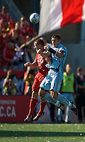 12 September 2009: Colorado Rapids defender Kosuke Kimura #27 and Toronto FC forward Chad Barrett #19 in action during MLS action at BMO Field Toronto in a game between Colorado Rapids and Toronto FC. .Toronto FC won 3-2..