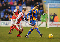 Fleetwood Town's Harrison Biggins keeps a watchful eye on Shrewsbury Town's Oliver Norburn<br /> <br /> Photographer Kevin Barnes/CameraSport<br /> <br /> The EFL Sky Bet League One - Shrewsbury Town v Fleetwood Town - Tuesday 1st January 2019 - New Meadow - Shrewsbury<br /> <br /> World Copyright © 2019 CameraSport. All rights reserved. 43 Linden Ave. Countesthorpe. Leicester. England. LE8 5PG - Tel: +44 (0) 116 277 4147 - admin@camerasport.com - www.camerasport.com