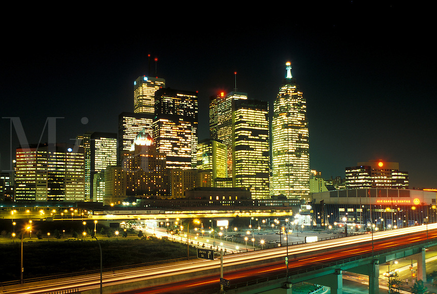 Toronto, Canada, Ontario, Skyline of downtown Toronto along Gardiner expressway in the evening.