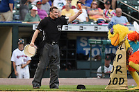 Umpire Brad Myers holds a chicken leg from a KFC bucket at the The Famous San Diego Chicken for on field entertainment during a game between the Indianapolis Indians and Rochester Red Wings on July 26, 2014 at Frontier Field in Rochester, New  York.  Rochester defeated Indianapolis 1-0.  (Mike Janes/Four Seam Images)