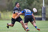 Taniela Tuivai gets his pass away before being tackled by Leki Aitola. Counties Manukau Premier Counties Power Club Rugby Round 2, Game of the Week, between Te Kauwhata and Onewhero, played at Te Kauwhata on Saturday March 17th 2018. <br /> Photo by Richard Spranger.<br /> <br /> Onewhero won the game 43 - 10 after leading 21 - 10 at halftime.<br /> Te Kauwhata EnviroWaste  10 - Lani Latu try,  Caleb Brown 1 conversion, Caleb Brown 1 penalty.<br /> Onewhero 43 - Jackson Orr 2, Ilaisa Koaneti 2, Vaughan Holdt, Zac Wootten, Rhain Strang tries, Vaughan Holdt 4 conversions.