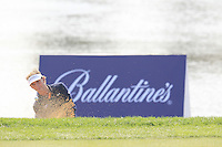 Joost Luiten (NED) chips from a bunker at the 8th green during Sunday's Final Round of the 2014 BMW Masters held at Lake Malaren, Shanghai, China. 2nd November 2014.<br /> Picture: Eoin Clarke www.golffile.ie