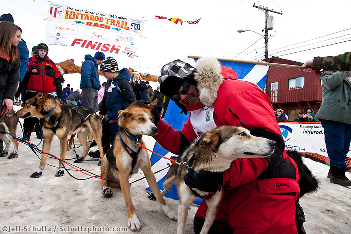 Wattie McDonald of Scotland poses with his lead dogs at the finish chute in Nome during the 2010 Iditarod
