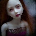 portrait of a doll with red lips
