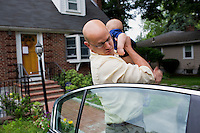 Fred Bermont holds son Dylan Bermont (age 9 months) as he drops the kids off at day-care in Lexington, Massachusetts, USA, before he goes to work on June 9, 2014. Bermont is the father of two children and shares parenting duties with his wife, Jen Bermont. Fred usually takes care of the morning routine, including feeding, dressing, and dropping the kids off at day-care, and Jen picks them up and watches over them in the afternoon. Fred is a Senior Clinical Standards Specialist at Shire, a pharmaceutical company with headquarters in Lexington.