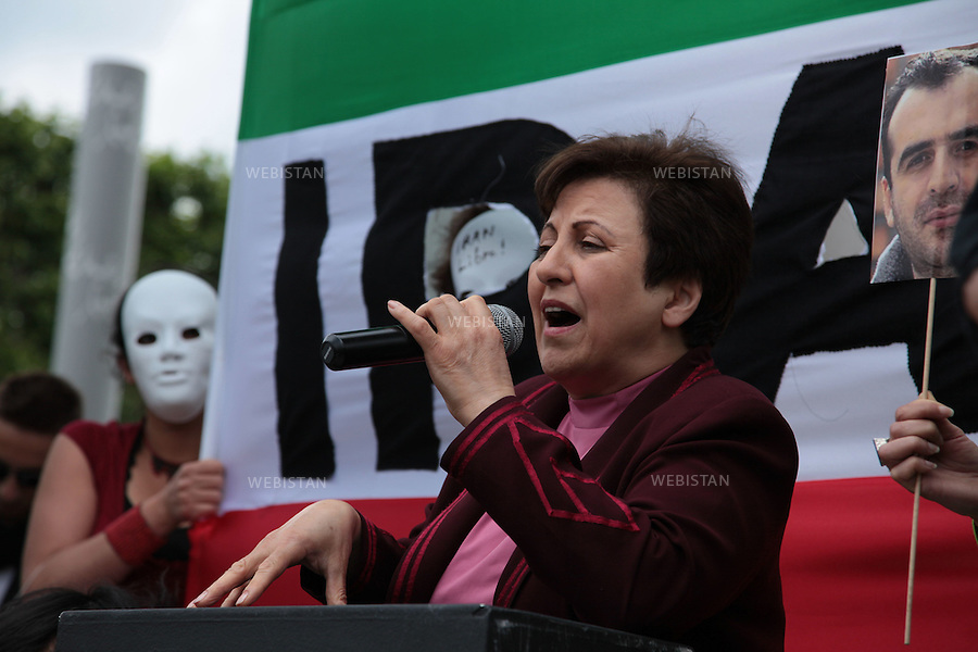FRANCE. PARIS. 12JUNE 2010: Shirin Ebadi, an Iranian lawyer, human rights activist and 2003 Nobel prize winner talking during the gathering of the Iranian in Paris on the first anniversary of the Iranian election. By Wearing a white mask and forming a human chain they showed their support for the Iranian movement in Iran and the anonymous prisoners who have been arrested in the context of post-election demonstrations in Iran..