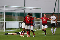 Manchester United U23 players congratulate Tahith Chong after scoring their second goal during Fulham Under-23 vs Manchester United Under-23, Premier League 2 Football at Motspur Park on 10th August 2018