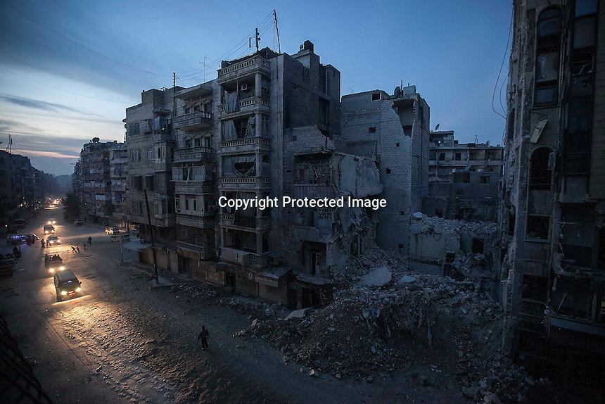 In this Thursday, Nov. 29, 2012 photo, night falls on a Syrian-rebel controlled area as destroyed buildings, among those the Dar Al-Shifa hospital, are seen in Sa'ar street after a warplane targeted the hospital last week killing dozens among medical staff and civilians in Aleppo, the Syrian's largest city. (AP Photo/Narciso Contreras).