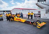 Jul 18, 2020; Clermont, Indiana, USA; Crew members push the dragster of NHRA top fuel driver Shawn Langdon during qualifying for the Summernationals at Lucas Oil Raceway. Mandatory Credit: Mark J. Rebilas-USA TODAY Sports