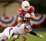 BRANDON, SD - SEPTEMBER 5: Andrew Sorensen #42 from Brandon Valley is brought down by Mason Wickherst #43 from Watertown in the first half Saturday night in Brandon. (Photo by Dave Eggen/Inertia)