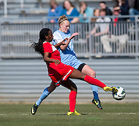 Hanna Gardner (71) of North Carolina fights for the ball withTiffany McCarty (14) of the Washington Spirit during the game at the Maryland SportsPlex in Boyds, MD.  The Washington Spirit defeated the North Carolina Tar Heels in a preseason exhibition, 2-0.