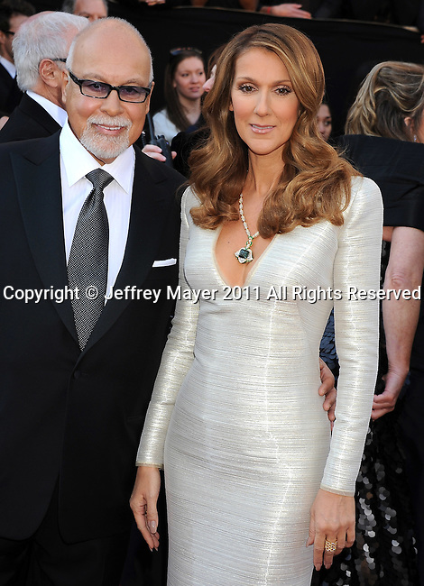HOLLYWOOD, CA - FEBRUARY 27: Rene Angelil and Celine Dion arrive at the 83rd Annual Academy Awards held at the Kodak Theatre on February 27, 2011 in Hollywood, California.