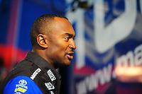 Feb. 17 2012; Chandler, AZ, USA; NHRA top fuel driver Antron Brown talks with fans at the Arizona Nationals at Firebird International Raceway. Mandatory Credit: Mark J. Rebilas-