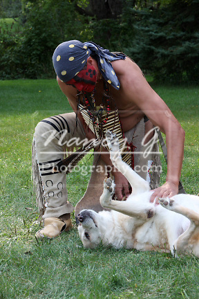 Native American Indian man petting his dog