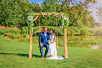 bride and groom on wedding swing