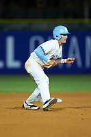 Logan Warmoth (7) of the North Carolina Tar Heels takes his lead off of second base against the Miami Hurricanes in the second semifinal of the 2017 ACC Baseball Championship at Louisville Slugger Field on May 27, 2017 in Louisville, Kentucky. The Tar Heels defeated the Hurricanes 12-4. (Brian Westerholt/Four Seam Images)