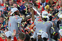 2nd February 2020, Miami Gardens, Florida, USA;   Kansas City Chiefs players hold up the Vince Lombardi Trophy on the podium after Super Bowl LIV on February 2, 2020 at Hard Rock Stadium in Miami Gardens