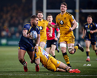 25th January 2020; Sixways Stadium, Worcester, Worcestershire, England; Premiership Rugby, Worcester Warriors versus Wasps; Ollie Lawrence of Worcester Warriors lays the ball off while being tackled by Matteo Minozzi of Wasps